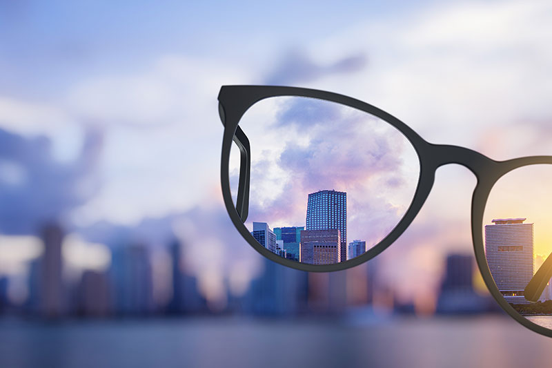looking through glasses to get a better view of a city