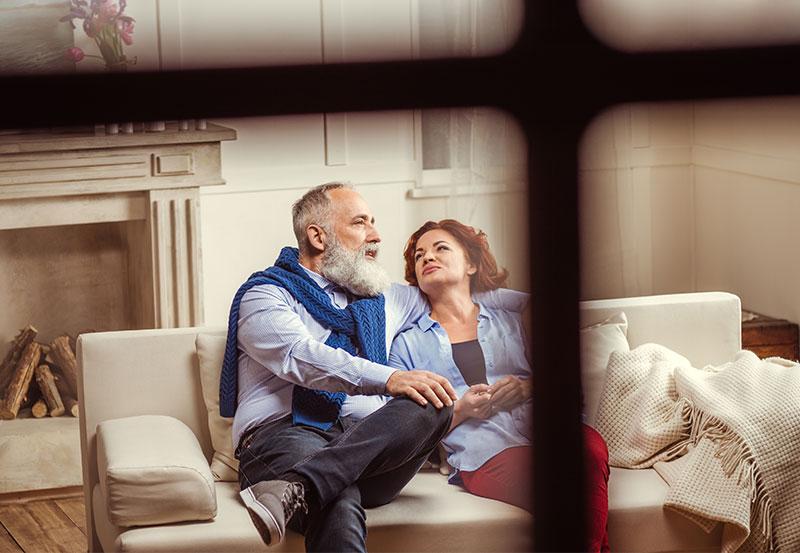 mature couple receiving financial asset management services